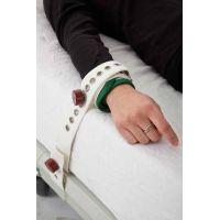 Attache-poignets ou chevilles à fermeture magnétique
